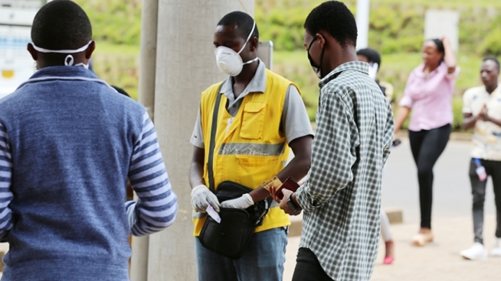 xa-mobile-money-agent-and-his-clients-wear-facemasks-in-kigali-yesterday-craish-bahizi_0.jpg.pagespeed.ic.ySlt23THk6